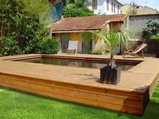 piscine semi enterrée en bois photos de poses de piscines semi enterr 233 es en bois par odyssea