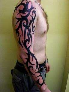Tribal Arm - 30 groovy tribal arm tattoos slodive