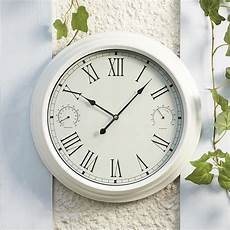 traditional garden wall clock and weather station