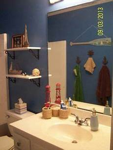 our bathroom decorations from hobby lobby paint color is valspar blue china shelves and