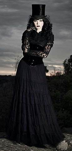 black corset with top hat and skirt steunk beauty