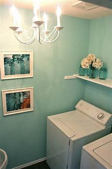 cute laundry room with rivers edge by behr paint color love the lighting i d spend all day in