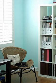 turquoise wall paint transitional den library office