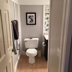 gray white black bathroom entry mixed metal touches