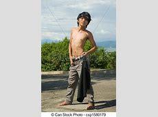 Asian boy fashion pose outdoors. Teenage asian skinny