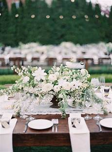 picture of a beautiful and large textural wedding centerpiece of greenery and white blooms is a