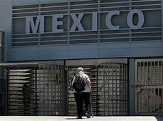 pedestrians pay toll show passports to enter mexico