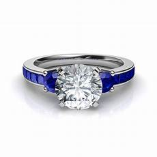 three stone princess cut engagement ring with blue