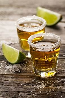 tasty alcohol drink cocktail tequila with lime and salt on