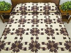 brown and tan double wedding ring quilt