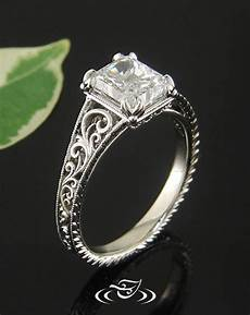 custom style ring in white gold with leaf prongs scroll pattern and filigree and a