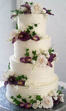 4 tier wedding cake textured buttercream and coordinating