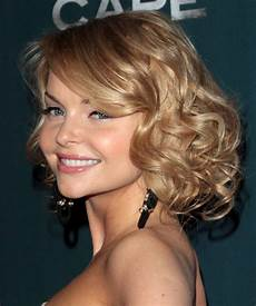 izabella medium curly hairstyle with side swept bangs