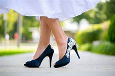 White Wedding Dress And Navy Shoes