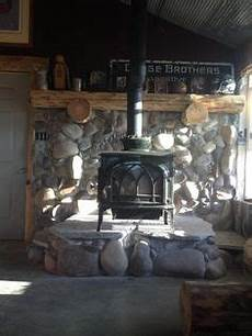 remodeling a stove wall shield with river rock faux rock stove wall brick