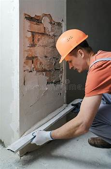 Worker With Plaster Rasp Stock Image Image Of