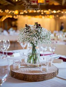 gorgeous baby s breath on wooden wedding centerpieces i love the sparkling lights in the