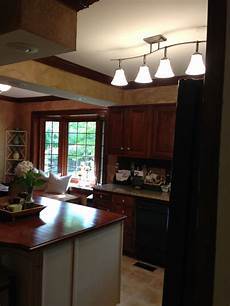 replaced fluorescent light in kitchen with 4 globe fixture kitchen lighting