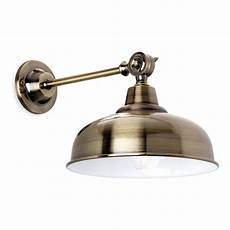 industrial design brass wall light with tap detailing