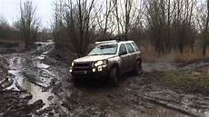 land rover freelander 1 roading in thick mud at mud