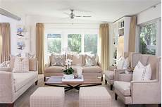 transitional white living room is light airy hgtv