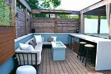 updated roof deck with fire pit outdoor bar and seating hgtv