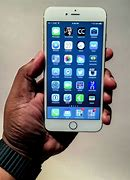 Image result for iPhone 6s Plus in Hand