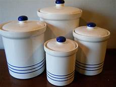 white kitchen canister set set 4 white eartenware kitchen canisters with blue stripes