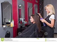Beautiful Female Hairdresser Working In Beauty Salon