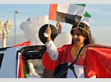 Little Emirati girl in national dress for National Day