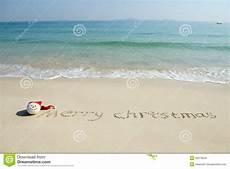 merry christmas written tropical white sand image of calendar christmas