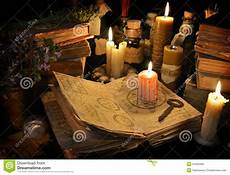 tipi di candele bloody candle on witch book in candle light stock photo