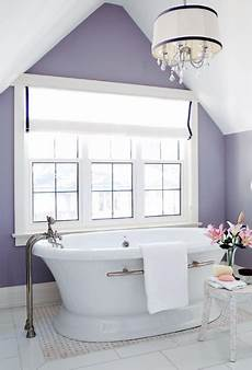 love this purple paint color in an all white bathroom
