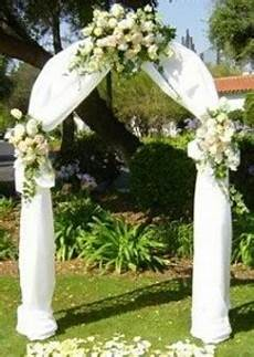 wedding decorations chair covers and bows and venue