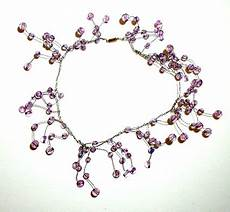 comment faire des bijoux en perles facile collier de perles 2 sur tete a modeler junior