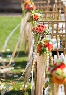 wedding chair swag decorations a simple fabric tieback with flower arrangement contrasts well