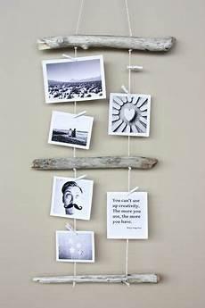 bilder kreativ aufhängen kreativ fotos aufh 228 ngen mit holz und garn
