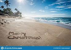 merry christmas written in the sand image of holiday paradise 167863744