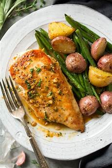 skillet chicken recipe with garlic herb butter sauce cooking