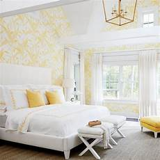 Yellow And Grey Wallpaper Bedroom Ideas by White And Yellow Bedroom Features A Vaulted Ceiling