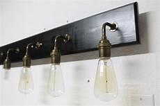 bathroom vanity l antique brass lighting by partyandhomedesign
