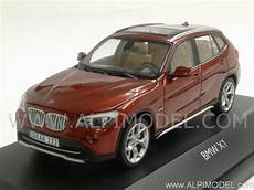 bmw x1 1 43 schuco bmw x1 2010 vermillion 1 43 scale model