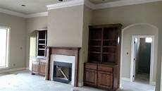 sherwin williams relaxed khaki walls panda white trim and weathered teak stain paint colors