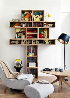 a reading corner with a creative design wooden shelf