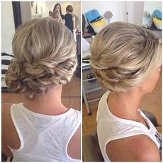 bridal hair wedding hair side bun curly bun side swept updo updo hairstyle in 2019