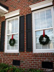 Decorations For Windows With Lights by How To Hang Wreaths From Vinyl Windows Diy