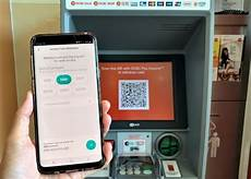 ocbc pioneers cash withdrawal from singapore atms using qr