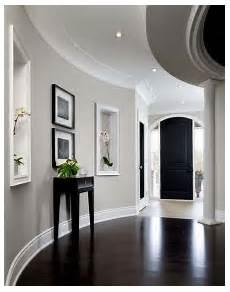 dark wood floors with light grey walls bedroom light