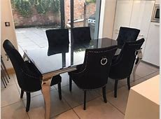 Black glass and chrome dining table with 6 knocker chairs