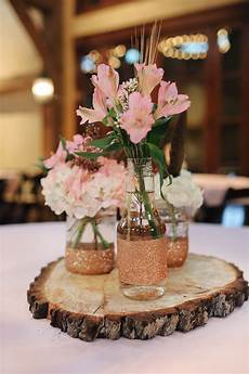 rustic tree stump centerpieces with jars and pink alstroemeria wedding pinterest